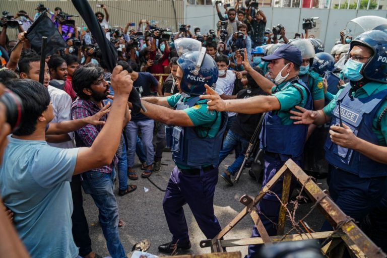 DHAKA, BANGLADESH - 2020/10/06: Students scuffle with police during a protest against an alleged incident of gang-rape. Student Union protesters took to the streets in protest against gang-rape and brutally torturing of a woman in the southern district of Noakhali in Dhaka. (Photo by Zabed Hasnain Chowdhury/SOPA Images/LightRocket via Getty Images)