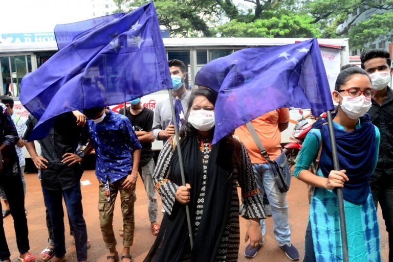 Student Union activists stage a demonstration in front of Ministry of Education demanding reducing the fee of school and college students during the Covid-19 Coronavirus pandemic in Dhaka, Bangladesh, on September 27, 2020. (Photo by Mamunur Rashid/NurPhoto via Getty Images)